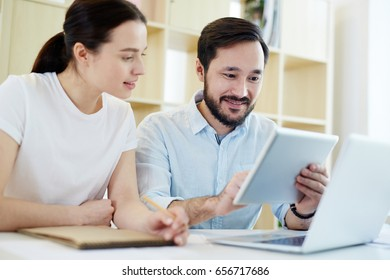 Businesspeople with gadgets browsing in the net and looking for necessary data