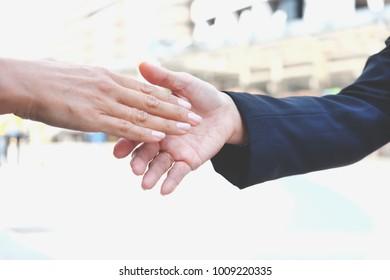Businesspeople giving handshake in the city, business handshake