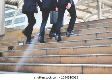 Businesspeople going up the stairs in big city, young businessmen walking up the stairs outside office, Business Lifestyle in modern city Concept
