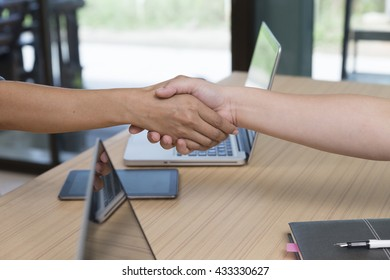 businesspeople handshaking for use as cooperation, acquisition, merger concept
