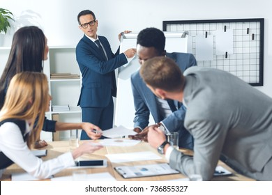 businesspeople having conversation in conference hall