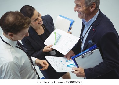 Businesspeople having discussion over document in office