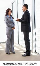 Businesspeople Having Informal Meeting In Office