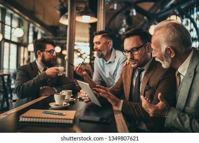 Businesspeople having meeting in the bar