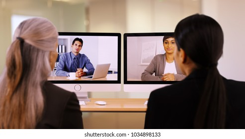 Businesspeople are having a video call to discuss work