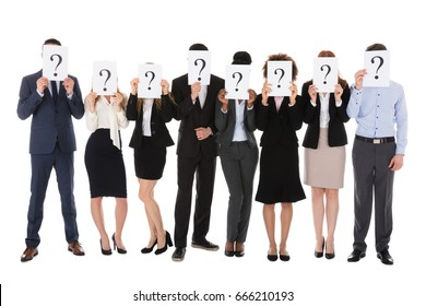 Businesspeople Hiding Behind Question Mark Sign Against White Background