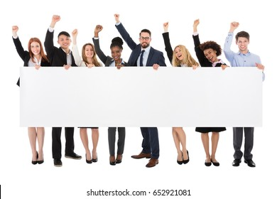 Businesspeople Holding Long Blank Banner Raising Their Arms