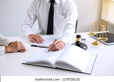 Businesspeople or lawyer having team meeting discussing agreement contract documents, judge gavel with Justice lawyers at law firm in background, Legal law, advice and justice concept.
