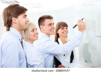 Businesspeople leader explaining draw marker on whiteboard, meeting in board room, businessman explaining colleagues group of business people team in office, conference