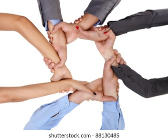 Businesspeople linking arms demonstrating business union, viewed from below.?