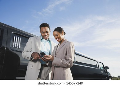 Businesspeople looking at cell phone