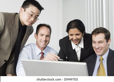 Businesspeople looking at a laptop.