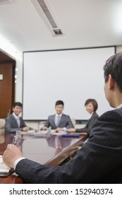 Businesspeople at a Meeting in a Conference Room