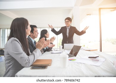businesspeople meeting and discussing with graph and chart and showing successful result using as background (concept of successful and achievement)