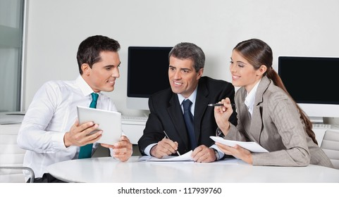 Businesspeople at a meeting with tablet computer in the office
