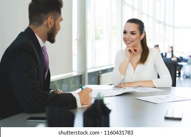 Businesspeople meeting and working and sharing documents in a desk at office
