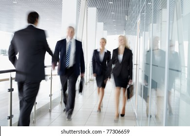 Businesspeople moving along the corridor