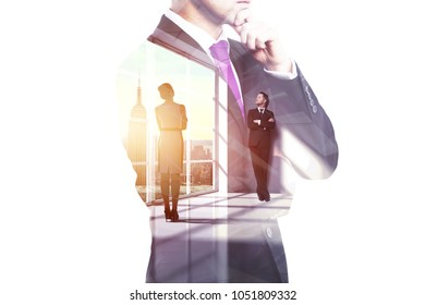 Businesspeople on abstract city background. Meeting and teamwork concept. Double exposure