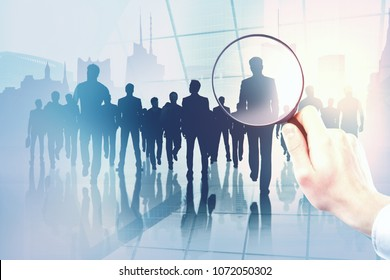 Businesspeople on abstract city background with magnifier. Meeting and research concept. Double exposure