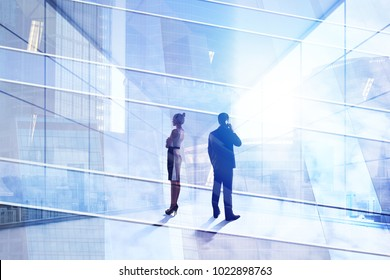 Businesspeople on abstract office city workplace background. Teamwork and employment concept. Double exposure