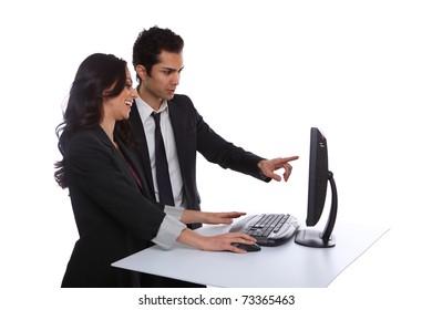 Businesspeople problem solving near a desktop computer
