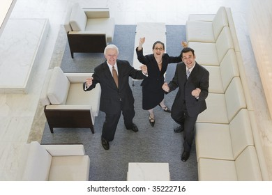 Businesspeople with raised arms