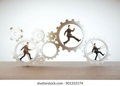 Businesspeople running inside abstract cogwheels on light background. Teamwork concept. 3D Rendering