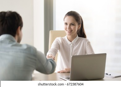 Businesspeople shaking hands after effective negotiation, making agreement, taking deal, female personnel manager in white shirt handshaking with applicant or client, hiring staff on company vacancy