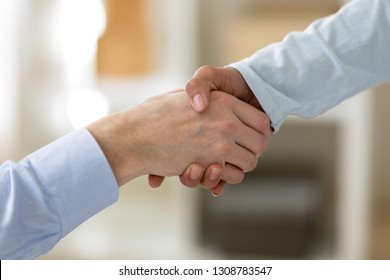 Businesspeople shaking hands female and male hands close up. After successful negotiations business partners handshaking showing respect. First meeting and impression, greeting or farewell concept