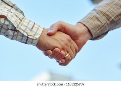 a businesspeople shaking hands, making an agreement.