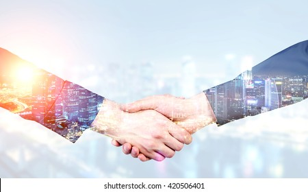 Businesspeople shaking hands on Singapore city background