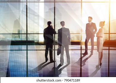 Businesspeople silhouettes in abstract glass office interior. Meeting and crowd concept. Double exposure