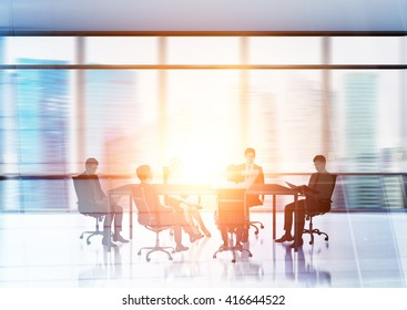 Businesspeople silhouettes in conference room with Singapore city in the background. Double exposure