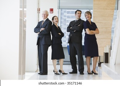 Businesspeople smiling.