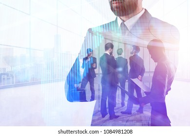 Businesspeople standing in abstract office interior with forex chart. Meeting, finance and analysis concept. Double exposure