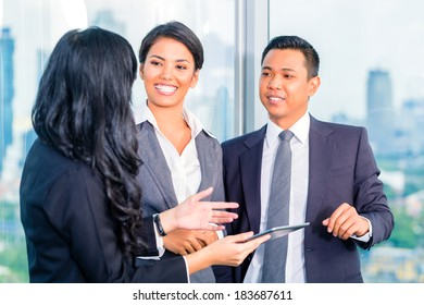 Businesspeople standing and talking