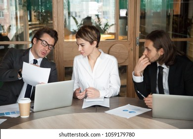 Businesspeople talking consulting about document, client discussing contract terms at meeting, partners or colleagues team brainstorming new project development working together at group negotiations