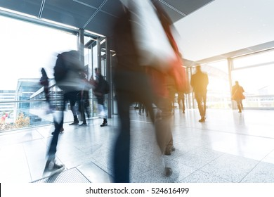 businesspeople walking in the corridor on a traid fair