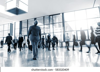 businesspeople walking at a Exhibition