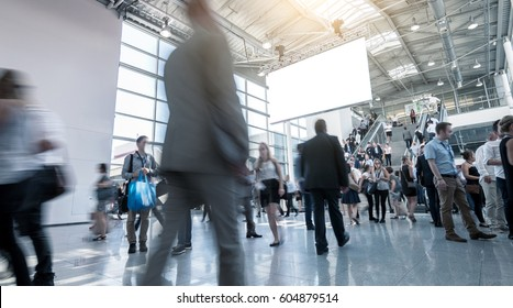 businesspeople walking International Trade Fair & Conference