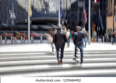Businesspeople walking past a office building