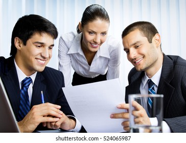 Businesspeople working with document at office. Success in business, partnership and teamwork theme concept.