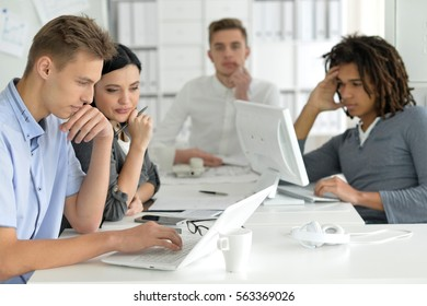 Businesspeople working in ofiice