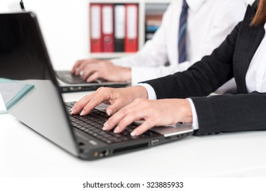 Businesspeople working on a laptop during training