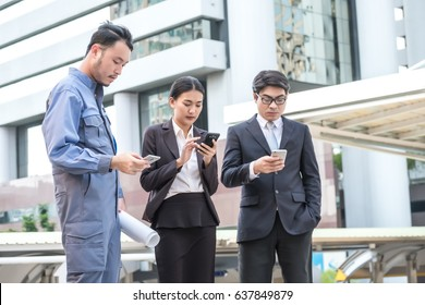 Businesspeople working on smart phone or digital device. Corporate Digital Device Connection Concept.