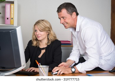 Businesspeople working together on a computer