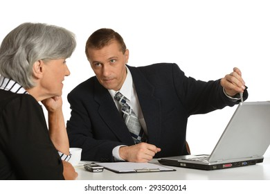 Businesspeople at the workplace with laptop on white background