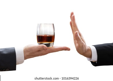 Businessperson' Hand Reject A Glass Of Whisk Offered By Partner On White Background