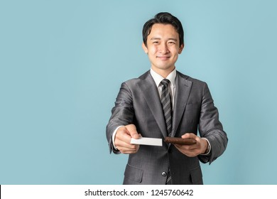 Businessperson holding a business card.