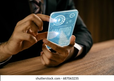 businessperson holding futuristic information device. graphical user interface(GUI). internet of things.
